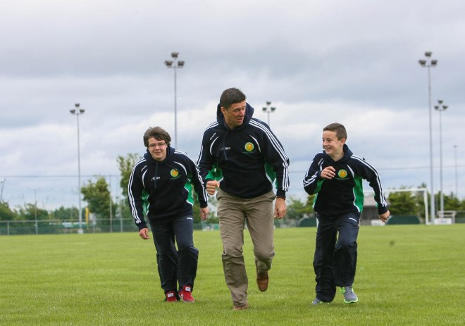 Team members Eoin Hurley and Oisin O'Gorman with Niall Quinn.